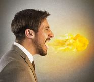 Businessman spits fire Royalty Free Stock Photo