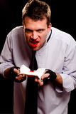 Businessman spitting blood Stock Photo