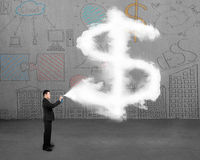 Businessman spraying dollar sign shape cloud paint with doodles Royalty Free Stock Photos