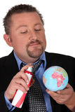Businessman spraying the world Stock Image