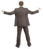 Businessman with spread arms and fists Stock Photos