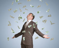 Businessman spread his arms. Money fall from above Royalty Free Stock Photography