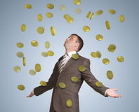 Businessman spread his arms. Money fall from above Royalty Free Stock Images