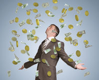 Businessman spread his arms. Money fall from above Stock Images