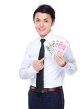 Businessman with spread of RMB. Isolated on white background Royalty Free Stock Photos