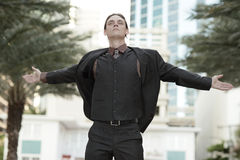 Businessman spreading his wings Royalty Free Stock Photography