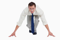 Businessman in sprinters position Stock Images