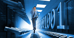 Businessman sprinting through data center Stock Image