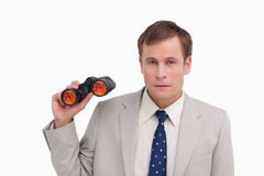 Businessman with spy glasses Stock Photos