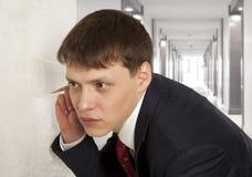 Businessman spying Stock Image