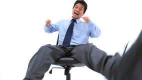 Businessman squirming on his chair Stock Photography