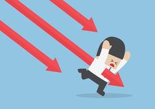 Businessman stabbed by downtrend arrow stock market Royalty Free Stock Images