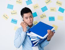 Businessman with stack of binders Stock Photos