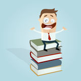 Businessman on a stack of books Stock Photos