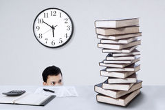 Businessman with stack of books Stock Image