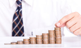 Businessman stack coin for increase your money Stock Image
