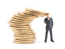 Businessman and stack of coins Stock Photo