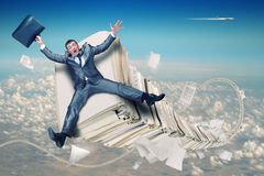Businessman on stack of paperwork. Scared businessman on huge stack of paperwork Royalty Free Stock Photos