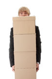 Businessman with stacked Boxes Stock Photos