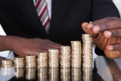 Businessman stacking coins Royalty Free Stock Photo
