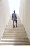 Businessman with stair - business concept Royalty Free Stock Photos