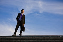 Businessman on stairs Royalty Free Stock Photo