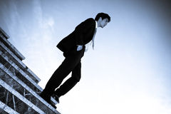 Businessman on stairs royalty free stock photography