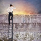 Businessman looks far for new business. Businessman on a stairs looks far for new business royalty free stock photo