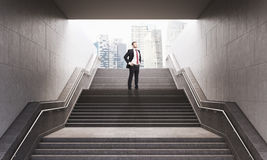Businessman on the stairs Royalty Free Stock Photography