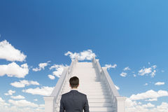 Businessman on stairs Royalty Free Stock Photos
