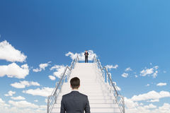 Businessman on stairs Royalty Free Stock Images