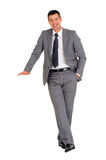 Businessman with stand. In white background Royalty Free Stock Photo