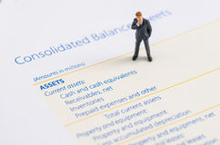 Businessman stand on the balance sheet Royalty Free Stock Photos