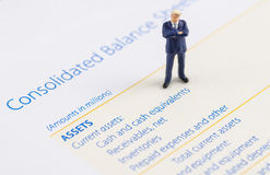Businessman stand on the balance sheet royalty free stock photography