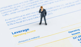 Businessman stand on the balance sheet Stock Images