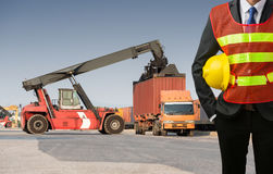 Businessman stand on front forklift loading Containers box Royalty Free Stock Image