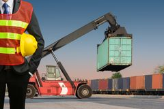 Businessman stand on front forklift loading Containers box. To Logistic cargo Import Export Royalty Free Stock Images