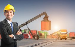 Businessman stand on front forklift loading Containers box. To Logistic cargo Import Export Background Royalty Free Stock Images