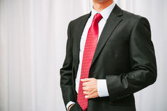 Businessman stand with informal gesture Stock Photography