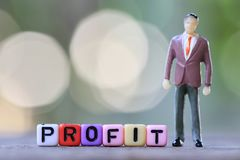 Businessman stand near textbox of Profit and green blur bokeh ba. Ckground in concept of growth in business Stock Photography
