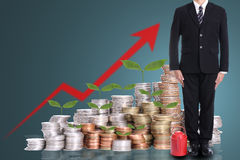 Businessman stand with red watering pot Stock Images