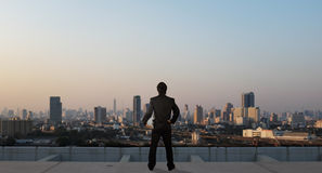 Businessman stand on roof top of skyscrabber, business concept. Businessman stand on roof top of skyscrabber, business industrial concept Royalty Free Stock Photo