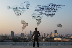 Businessman stand on roof top of skyscraper examine word cloud Stock Image