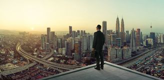 Businessman stand at rooftop looking great cityscape view stock photos