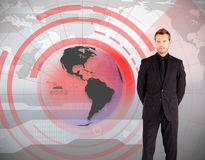 Businessman standing against global interface Stock Photography