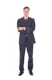 Businessman standing against white background Stock Images