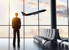 Businessman standing in airport Royalty Free Stock Photo