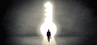 Businessman standing in a big keyhole royalty free stock photography