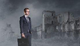Businessman standing on apocalyptic background. Crisis, default, Stock Photography