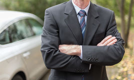 Businessman standing with arm crossed Stock Photo